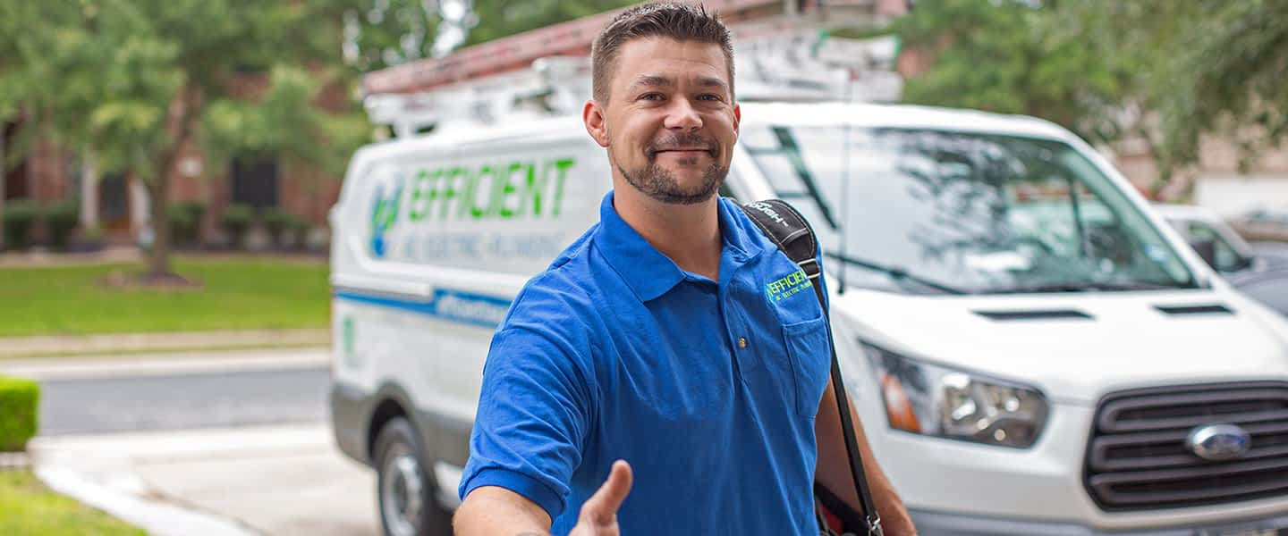 man in front of Efficient AC van reaching out to shake hands