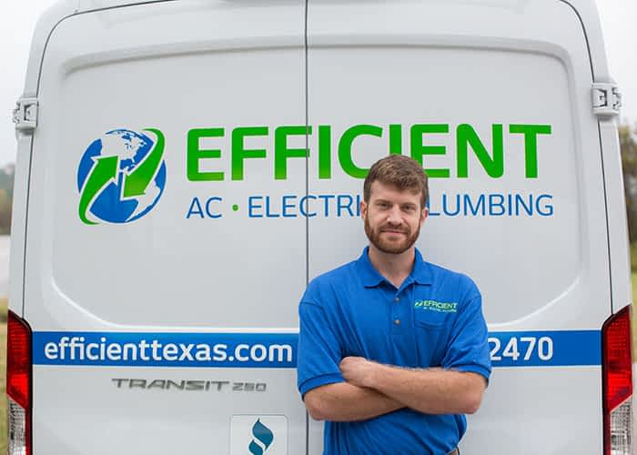 Efficient AC, Electric & Plumbing electrician Steven Schexnayder standing in front of his work truck.